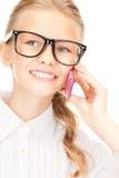 Muchacha feliz con el teléfono celular Foto de archivo libre de regalías