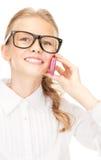 Muchacha feliz con el teléfono celular Fotos de archivo