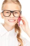 Muchacha feliz con el teléfono celular Foto de archivo