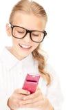Muchacha feliz con el teléfono celular Fotos de archivo libres de regalías