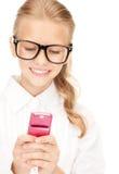 Muchacha feliz con el teléfono celular Fotografía de archivo libre de regalías