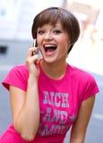 Muchacha feliz con el teléfono móvil Fotografía de archivo