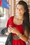 Muchacha feliz con el teléfono móvil Imágenes de archivo libres de regalías
