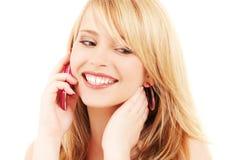 Muchacha feliz con el teléfono rosado Foto de archivo libre de regalías