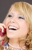 Muchacha feliz con el teléfono rosado Imagen de archivo libre de regalías
