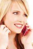 Muchacha feliz con el teléfono rosado Imágenes de archivo libres de regalías
