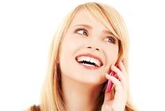 Muchacha feliz con el teléfono rosado Fotos de archivo libres de regalías