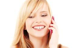 Muchacha feliz con el teléfono rosado Fotografía de archivo libre de regalías
