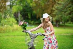 Muchacha feliz con la bicicleta Imagen de archivo