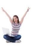 Muchacha feliz con la computadora portátil Foto de archivo