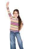 Muchacha feliz con la mano aumentada fotografía de archivo