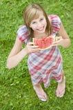 Muchacha feliz con la sandía Fotos de archivo