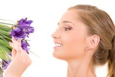 Muchacha feliz con las flores Fotos de archivo libres de regalías