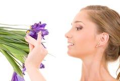 Muchacha feliz con las flores Imagenes de archivo