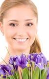 Muchacha feliz con las flores Foto de archivo libre de regalías