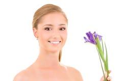 Muchacha feliz con las flores Imagen de archivo libre de regalías