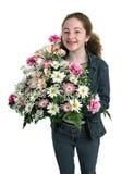 Muchacha feliz con las flores Fotos de archivo