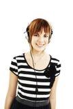 Muchacha feliz con los auriculares Fotos de archivo