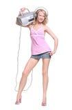 Muchacha feliz con los auriculares y el boombox de la música Foto de archivo