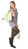 Muchacha feliz con los bolsos de compras Foto de archivo