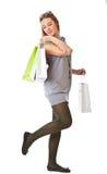 Muchacha feliz con los bolsos de compras Foto de archivo libre de regalías