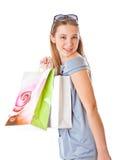 Muchacha feliz con los bolsos de compras Fotografía de archivo libre de regalías
