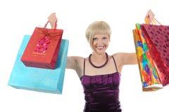 Muchacha feliz con los bolsos de compras. Fotos de archivo