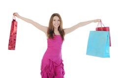 Muchacha feliz con los bolsos de compras. Fotografía de archivo libre de regalías