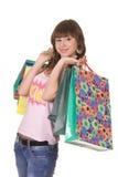 Muchacha feliz con los bolsos de compras Fotos de archivo