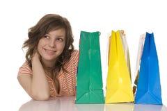 Muchacha feliz con los bolsos de compras Imágenes de archivo libres de regalías