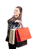 Muchacha feliz con los bolsos de compras en blanco Imágenes de archivo libres de regalías