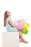 Muchacha feliz con los globos Foto de archivo libre de regalías