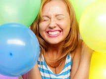 Muchacha feliz con los globos Fotos de archivo libres de regalías