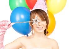Muchacha feliz con los globos coloridos Fotografía de archivo libre de regalías