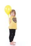 Muchacha feliz con los globos coloridos Foto de archivo