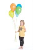 Muchacha feliz con los globos coloridos Fotos de archivo libres de regalías