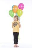 Muchacha feliz con los globos coloridos Imagen de archivo
