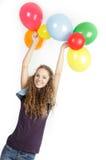 Muchacha feliz con los globos coloridos encima Fotos de archivo libres de regalías