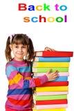Muchacha feliz con los libros del color de la pila Fotografía de archivo
