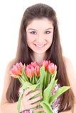 Muchacha feliz con los tulipanes rosados Imágenes de archivo libres de regalías
