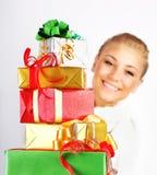 Muchacha feliz con muchos regalos Fotografía de archivo libre de regalías