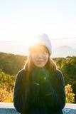 Muchacha feliz con salida del sol Fotografía de archivo libre de regalías