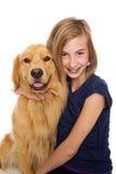 Muchacha feliz con su perro Foto de archivo libre de regalías