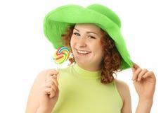 Muchacha feliz con un caramelo Fotografía de archivo libre de regalías