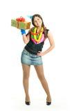 Muchacha feliz con un presente Imágenes de archivo libres de regalías