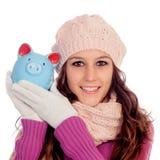 Muchacha feliz con una dinero-caja Foto de archivo libre de regalías