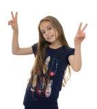 Muchacha feliz con Victory Gesture Foto de archivo libre de regalías