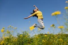 Muchacha feliz de salto Foto de archivo