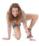 Muchacha feliz del adolescente que se sienta en el suelo Imágenes de archivo libres de regalías
