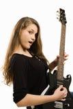Muchacha feliz del adolescente que toca la guitarra Imágenes de archivo libres de regalías